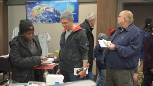 Attendees looking at brochures