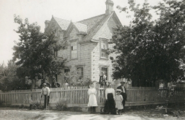 Simon T. Beck Family Home.  Charlie Beck is in the front with crutches.