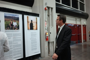 Matt Duhamel looking at The Forgiveness Project Exhibit
